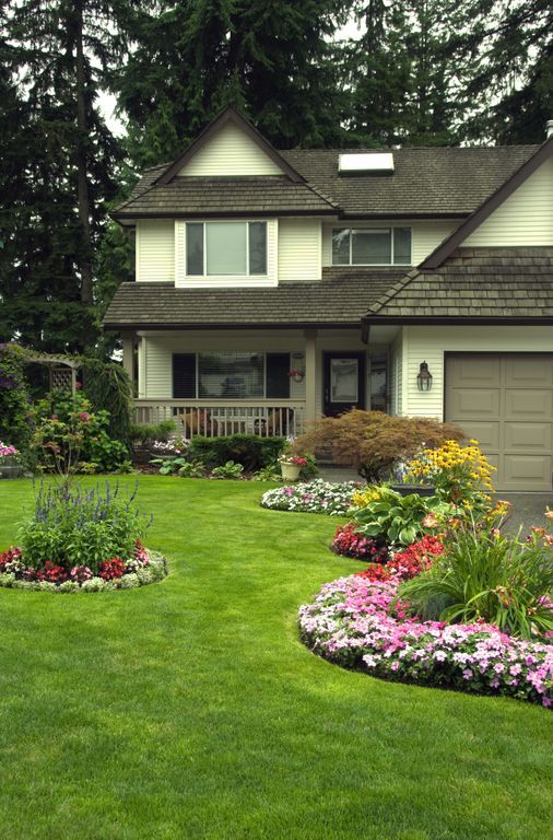 a wonderful front yard with lots of landscaping ideas here  nice touch of plants    flowers on
