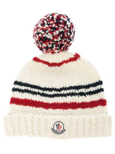 caf9d956415 Nude wool knitted beanie hat from Moncler featuring an all over ribbed  design