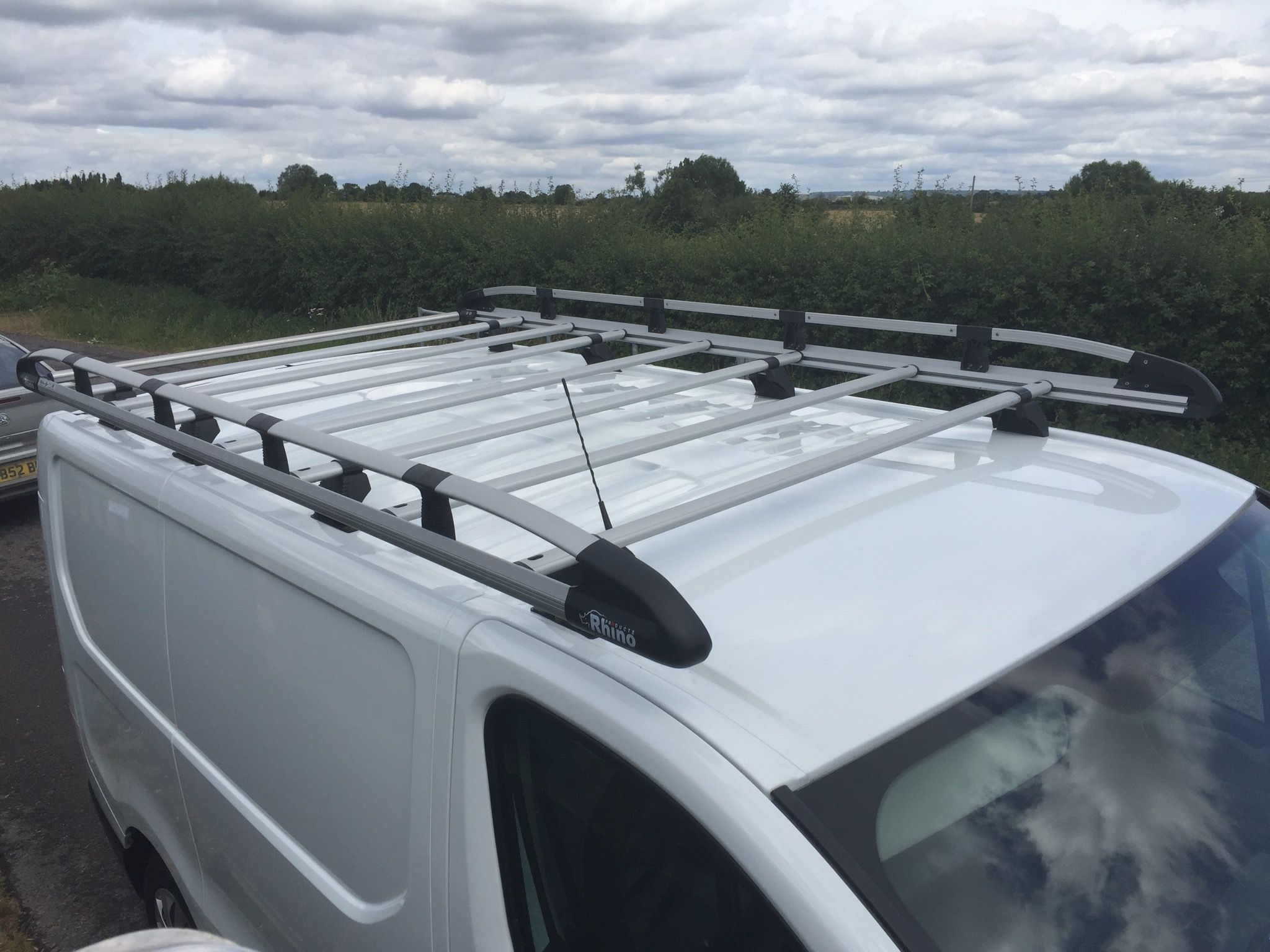 them slide pioneer gear down is simple accessories onto platform vehicle the rack from roofracks easily roof tie online your store to and racks rhino loading unloading