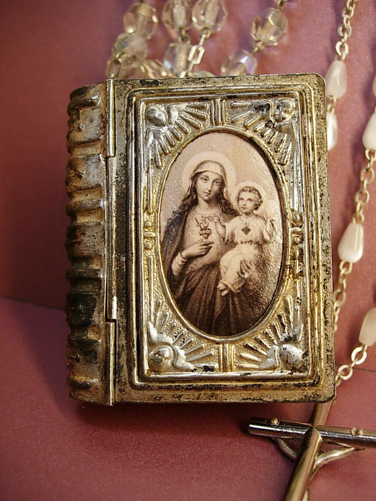 ANtique French Glass Rosary box necklace with  rosary inside Mary Portrait. $175.00, via Etsy.