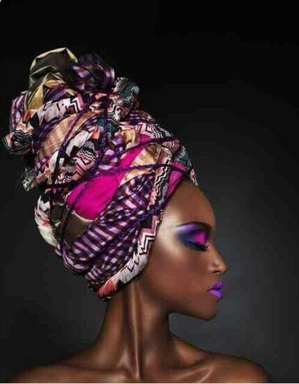 I see a coiled wrap and a purple string swirling around this African head wrap.