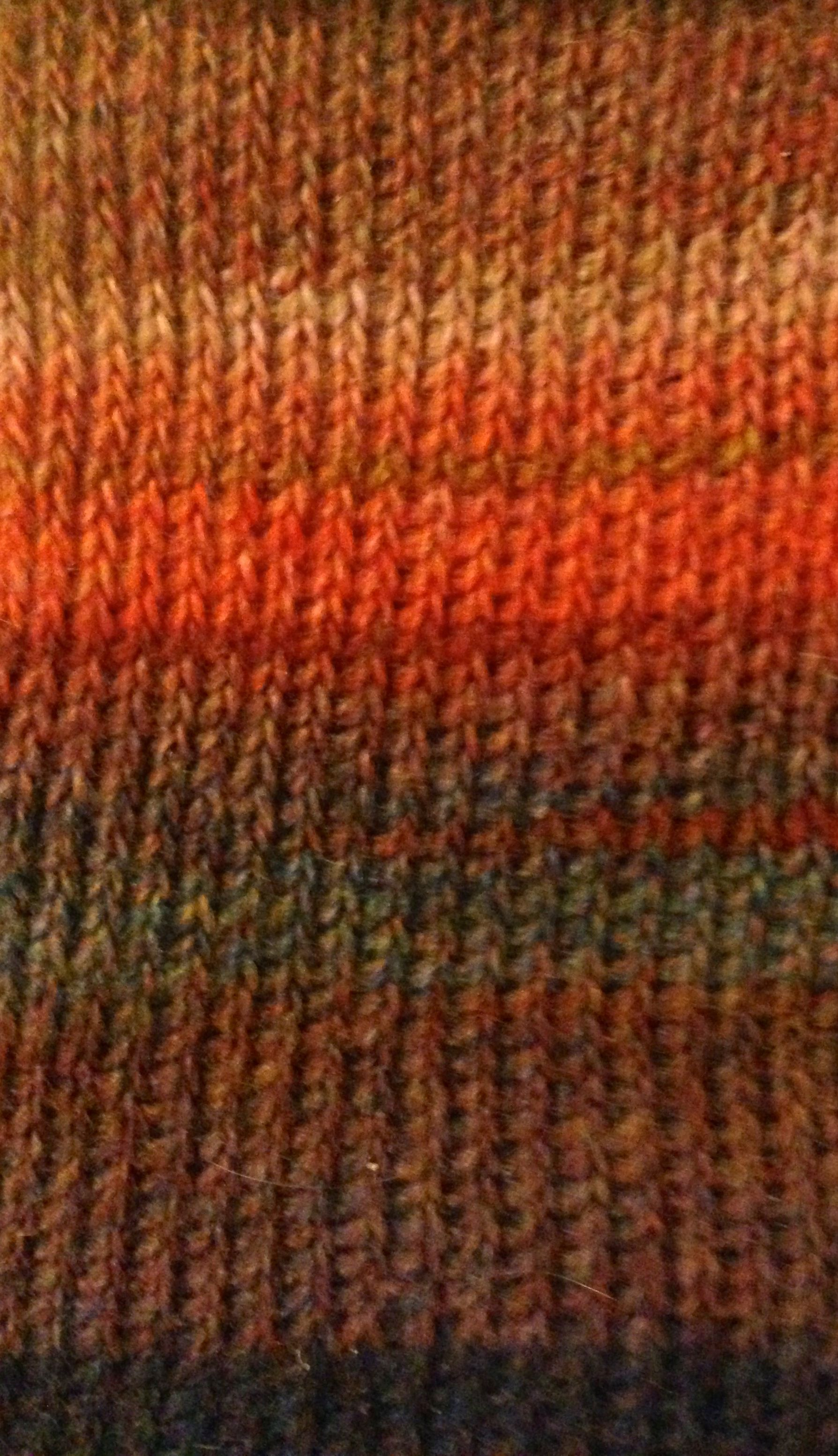 Completed swatch of Tunisian knit stitch in color-changing yarn ...