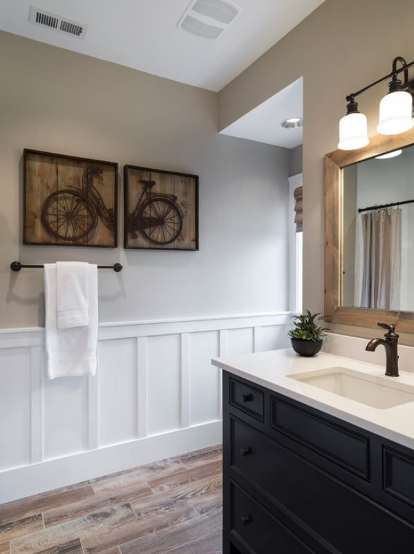 Beautiful Bathroom! Wood Tile Floors, Black Vanity, Bronze Fixtures, And  The White Wainscoting. Houzz.com