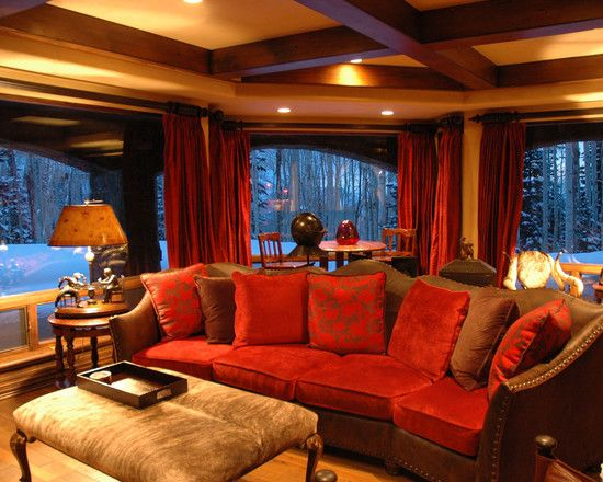 Mediterranean Media Room With Charming Brown Couch And Red Brown Cushions  Also Antique Padded Coffee