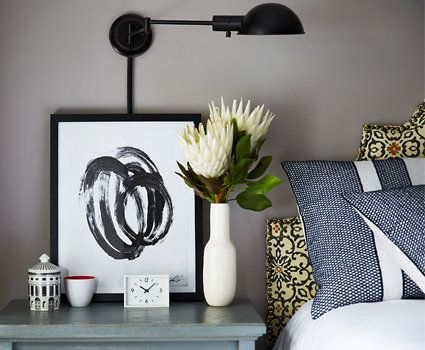 """One Kings Lane - The Starter Space SMALL-SPACE TIP #6  """"Think beyond surface space.  A sconce can easily replace a  bedside lamp, as it does here.  Things get cluttered really quickly  in a small space, so maximize  vertical areas wherever you can."""" —Andrew Stewart,  One Kings Lane stylist"""