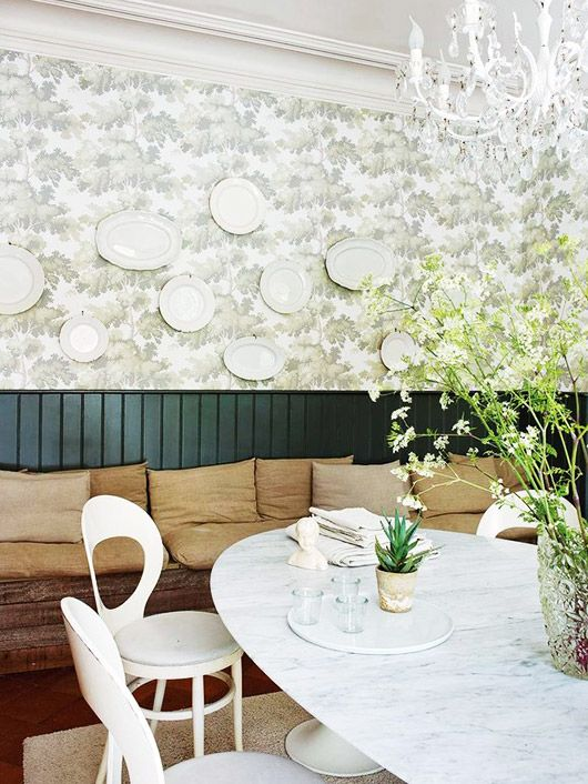 Modern Dining Space With White Plates On Wall And Marble Table With Built In  Bench Ideas