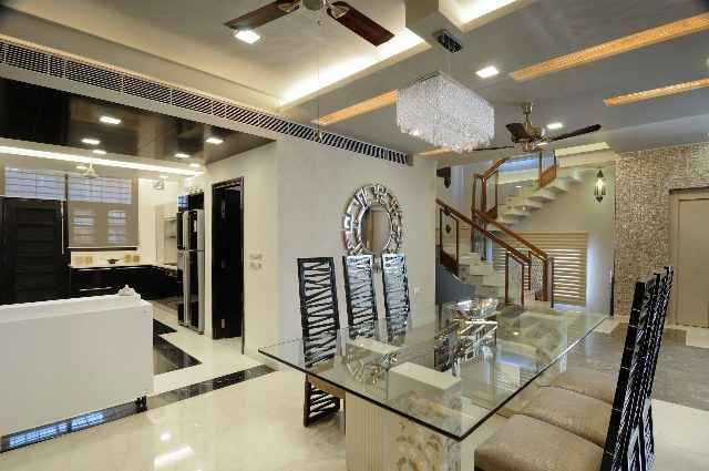 Modern Dining Room with Glass Table Design by Kapil ...