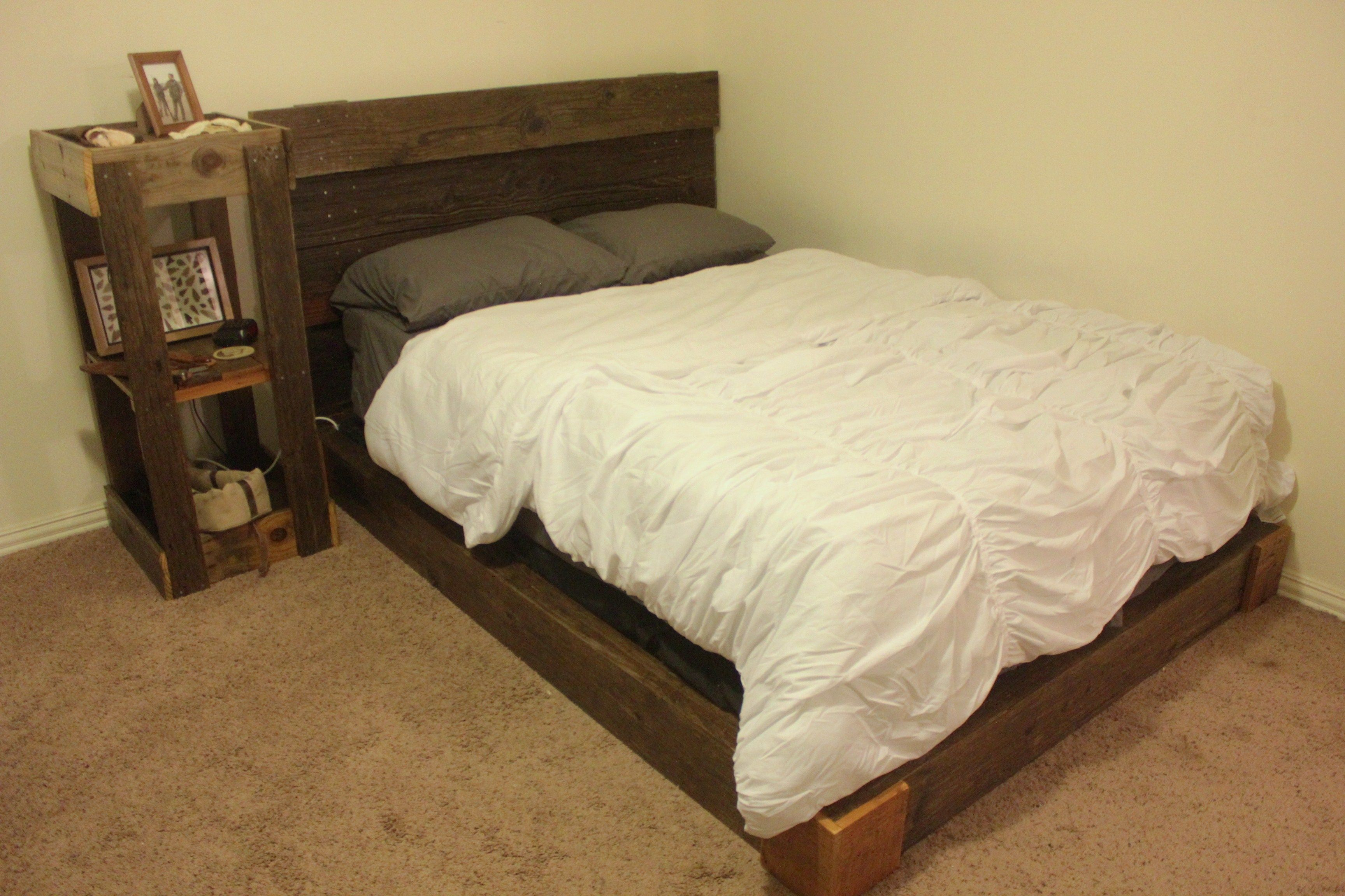 The rustic bed frame is 8 old 2X8s and a board from a pallet and the ...