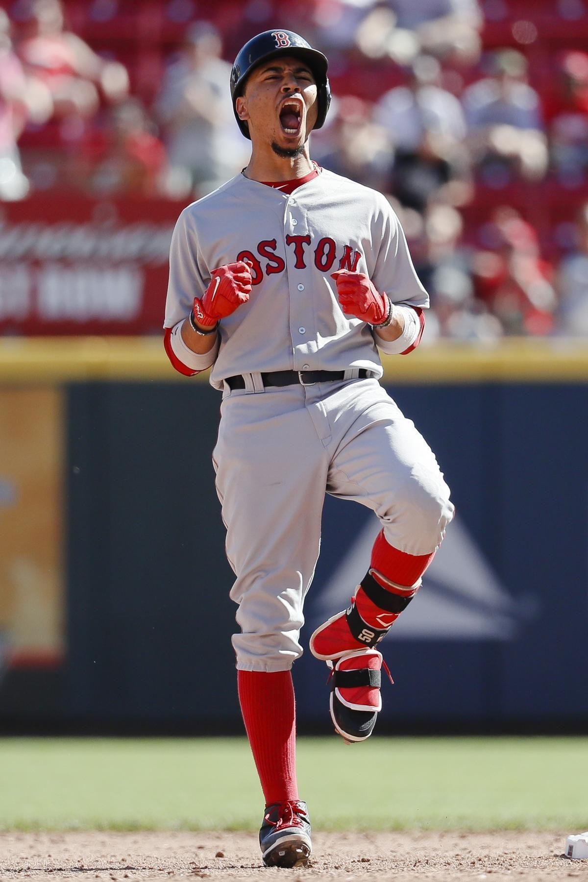 bb80cb23697 Boston Red Sox s Mookie Betts reacts after hitting the game-tying three-run  double off Cincinnati Reds relief pitcher Raisel Iglesias in the eighth  inning ...