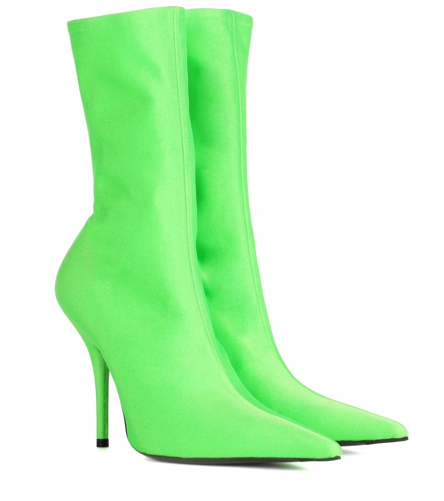f56ce1547f4c Balenciaga - Knife ankle boots - Make a daring statement in Balenciaga s  neon-green ankle boots and their exaggerated pointed toe.