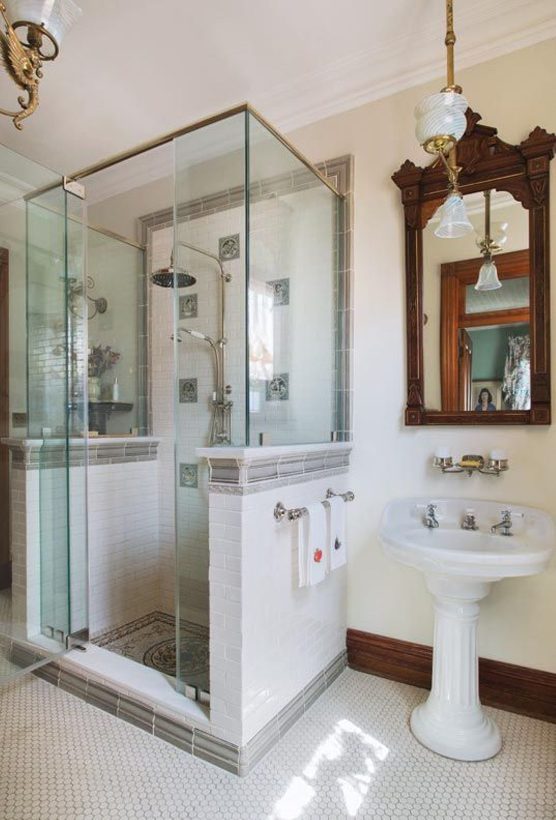 Wonderful Bathroom With Walk In Shower And Ornate Wooden Mirror Over  Pedestal Sink