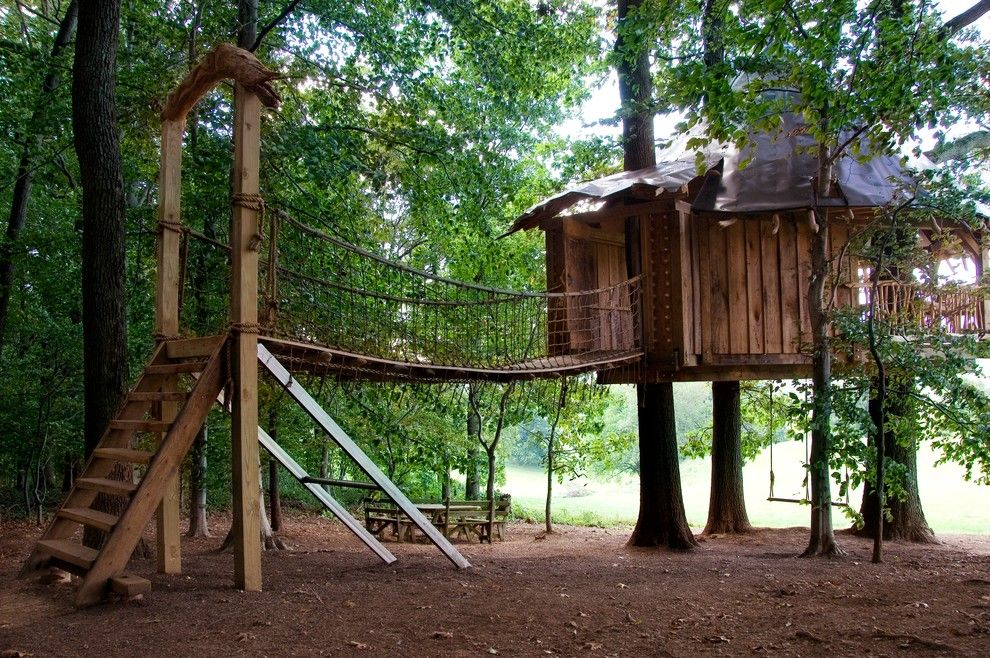 Dazzling Treehouse Austin look Philadelphia Tropical Kids Inspiration with balcony branches cone roof dormer Hugh Lofting Timber Framing logs metal roof rope bridge