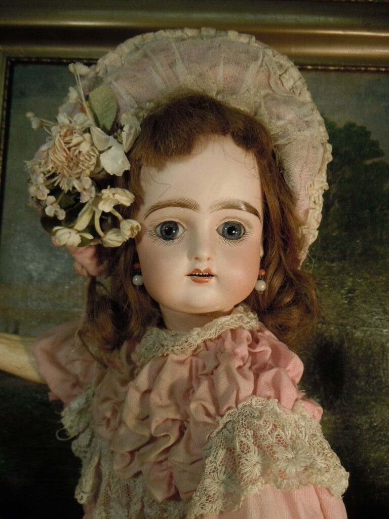 Beautiful French Bisque Bebe  Pintel&Godchaux   Paris~~~Bisque socket head with elongated and very full lower face. Large blue paperweight inset eyes painted lashes ,accended eye, corners and nostrils ,open mouth , Outlined lips , French composition body 5 pieces