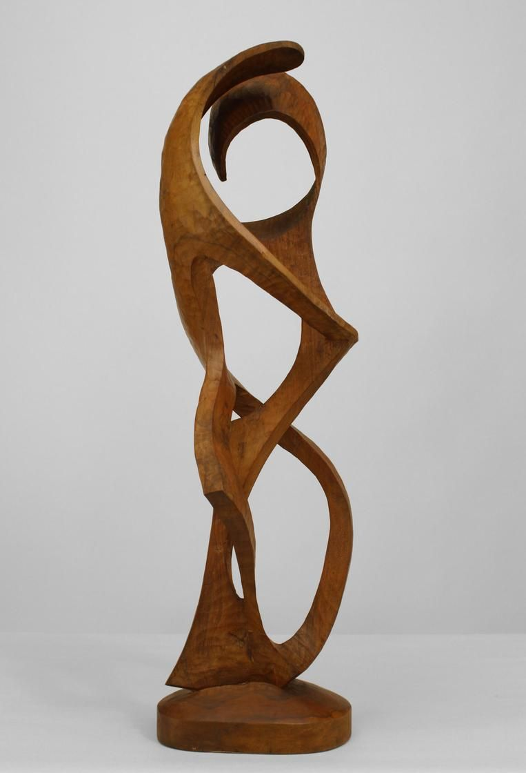 Contemporary maple (ambrosia wood) abstract sculpture of a free form vertical carving with open design surrounded with scrolls eminating from a solid base