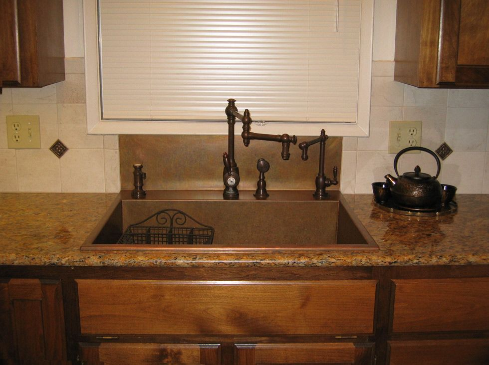 Like the integrated backsplash that goes up to the window for Replacing backsplash
