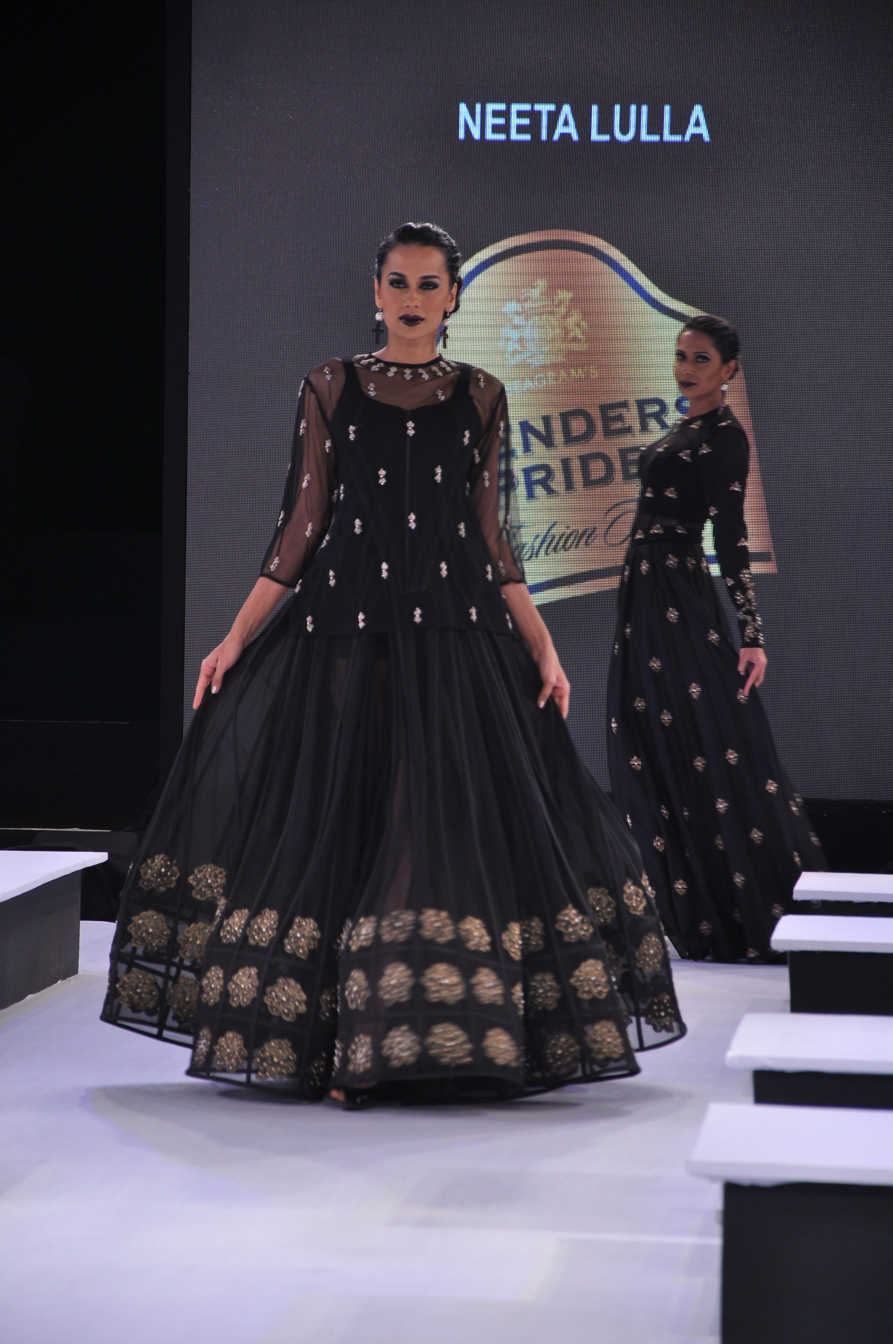 Black boti georgette shirt with a black lehenga with embroidery.