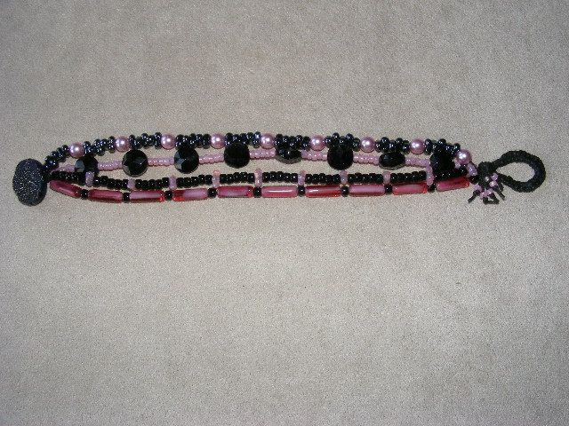 A vintage button & loop closure on the pink & black 4 strand  bracelet made with waxed linen. http://beckypancakebeaddesigns.blogspot.com