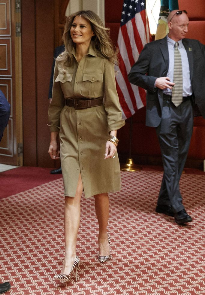 a08076c5120d Melania Trump wears a Ralph Lauren Collection safari shirt-dress with brown  and white striped pumps during a visit to the American International School  on ...