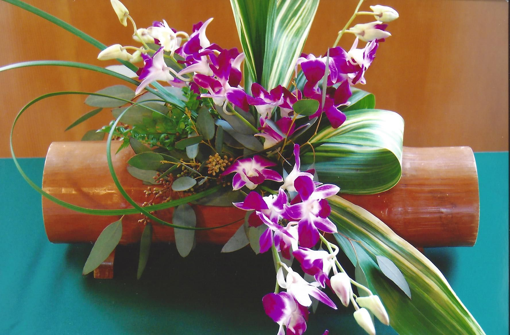 Dendrobium Orchid Exotic Arrangement in a Bamboo Design Container #TropicalWedding #Centepieces #TropicalFlowers #DuaneCruz