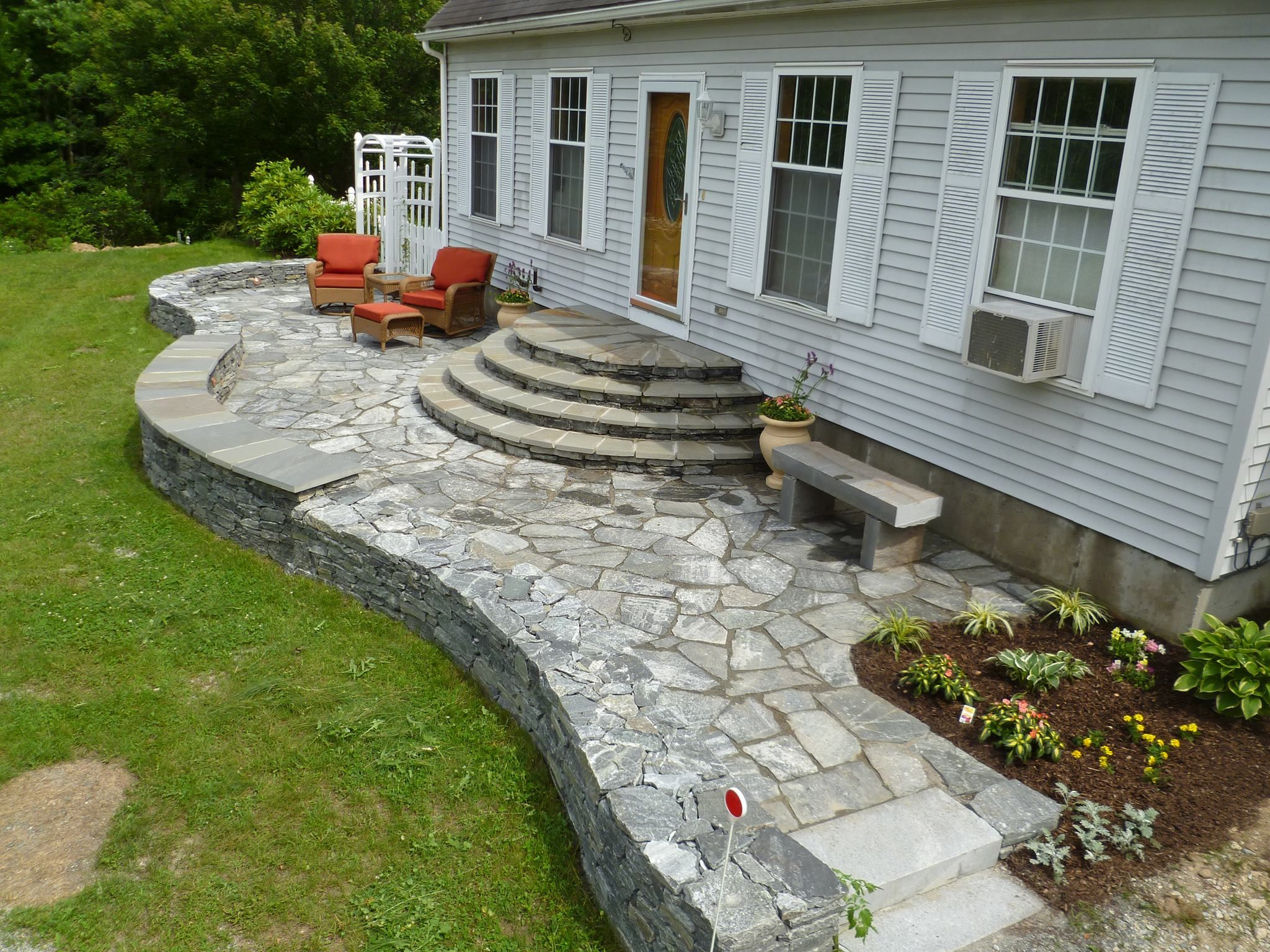 Nice patio Rounded steps leading from back door