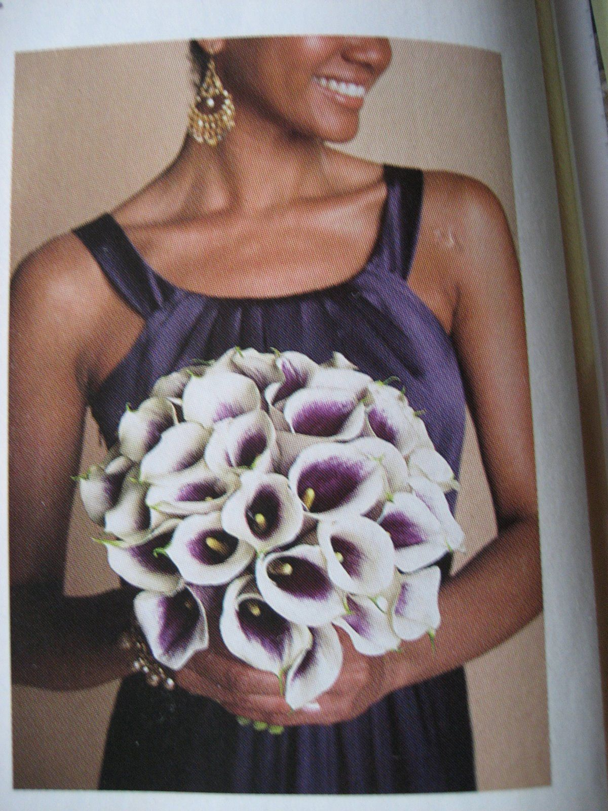 my bouquet WILL be made of these flowers. bride's maids bouquets will be white and purple calla lilies mixed together<3
