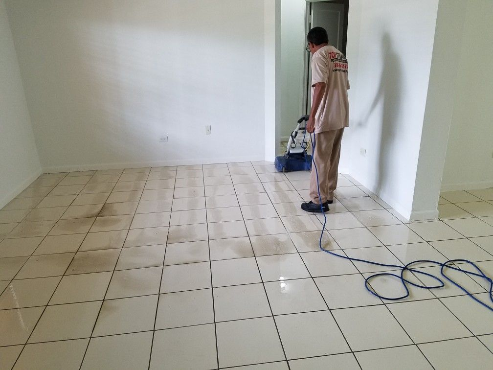 Deep scrubbing a tile and grout in a Miami house before