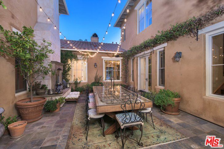 Pin for Later: You Won't Believe Who Just Bought Selena Gomez's Cursed House  This al fresco dining area is made for dinner parties. Perhaps Selena invited neighbors like the Kardashians over for an elegant bite.