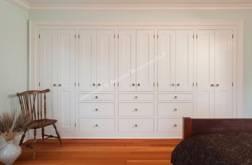 A Solid Wall Of Built In Storage Cabinets And Warm Fir Floors In The Second Floor Guest Bedroom