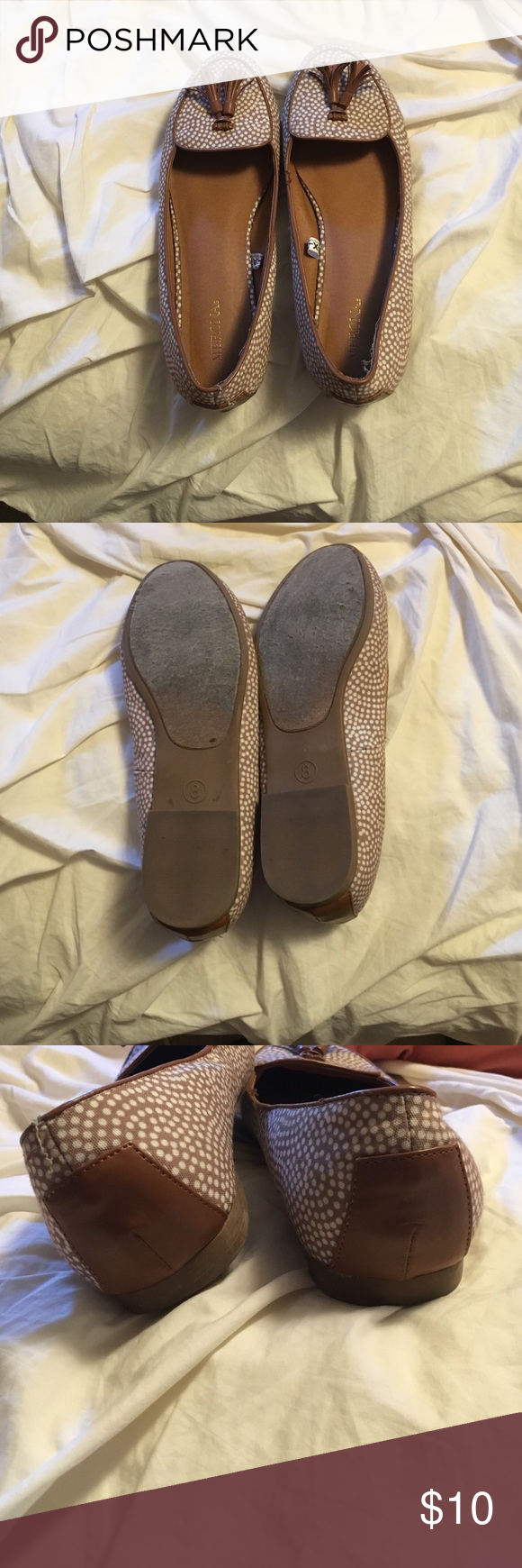 Brown/tan flats flats with tie detail. Natural wear but in great shape! Merona Shoes Flats & Loafers