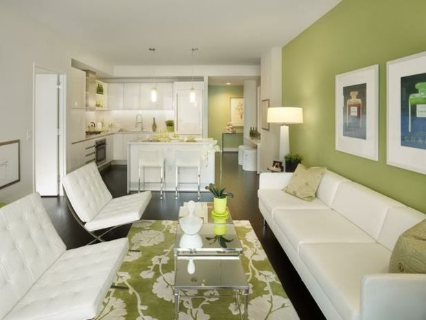 lindengrüne Wände weiße Möbel Wohnzimmer einrichten Ideen - wohnzimmer grun orange