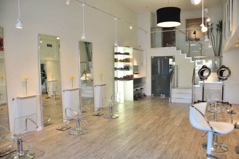 decorating minimalist hair salon design layouts with staircase and black drum shaped pendant light also