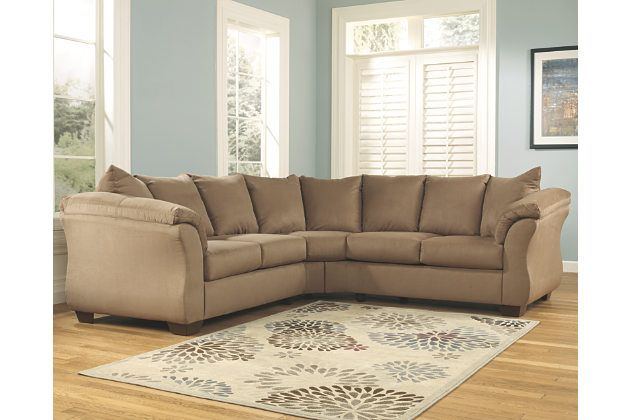 Talk about fine lines and great curves. That's the beauty of the Darcy 2-piece sectional—made to suit your appreciation for contemporary style with a softer side. Rolled pillow-top armrests beautifully go with the flow. Monochromatic upholstery makes a clean, sophisticated statement.