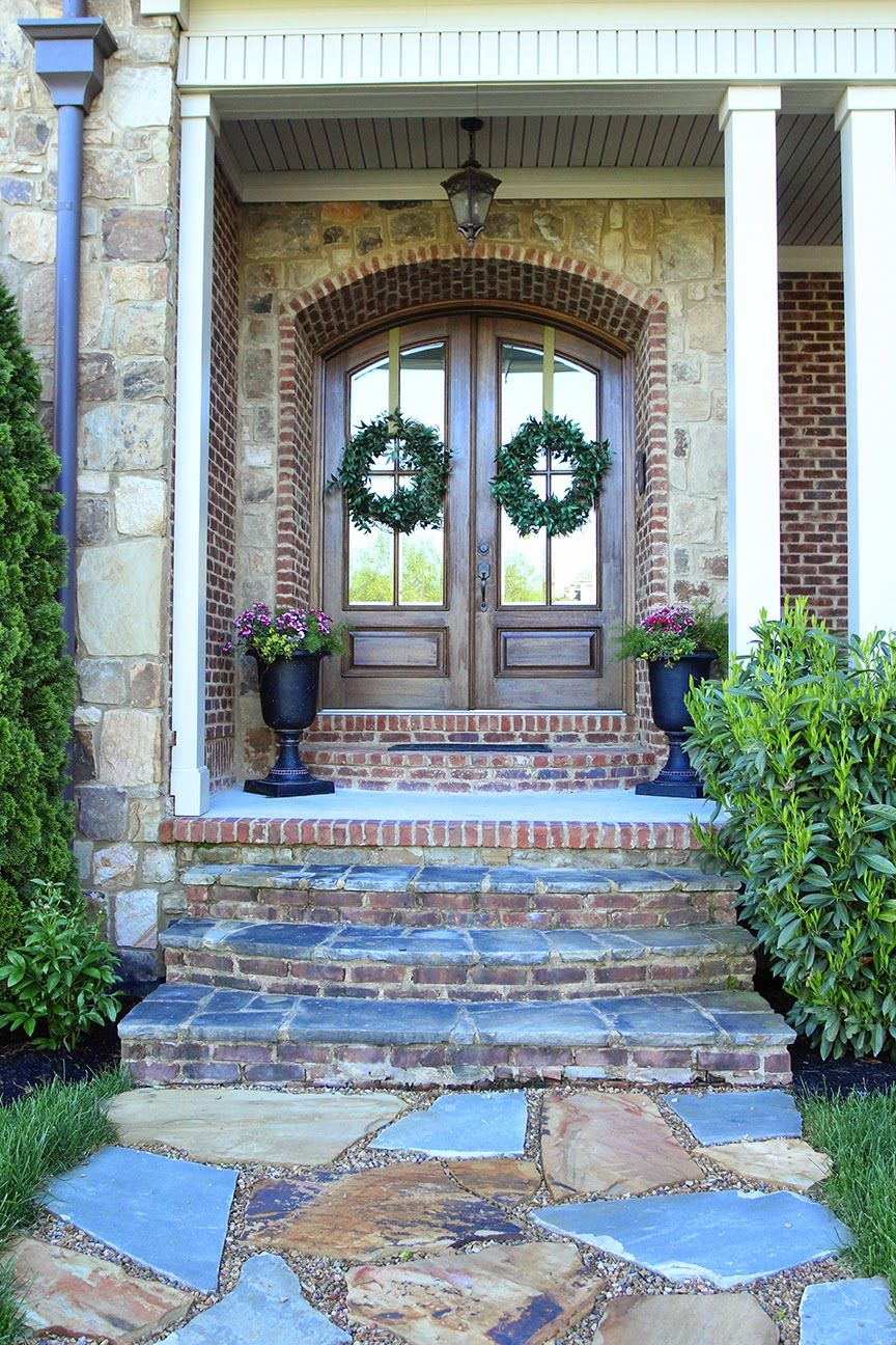 Double arched front doors, stone path, urn planters | Gege ...