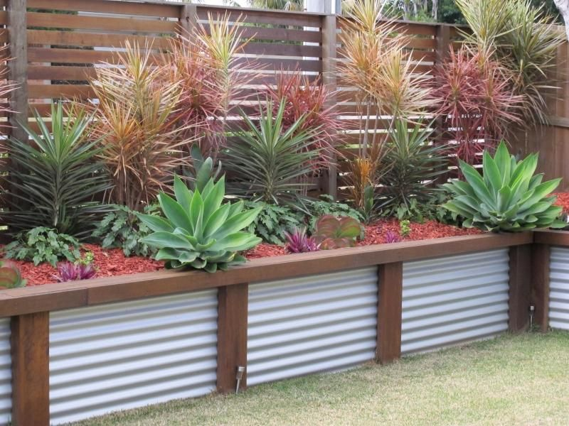 Scenic Scapes Landscaping   Corrugated Iron Retaining Wall With Hardwood  Sleeper Posts And Kwila Slat Screen Fence