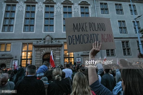 Protesters during the ' Solidarity Chain of Light ' protest are seen in Gdansk, Poland on 20 July 2017 Crowds gathered outside the Regional Court in Gdansk and other cities around the country to...