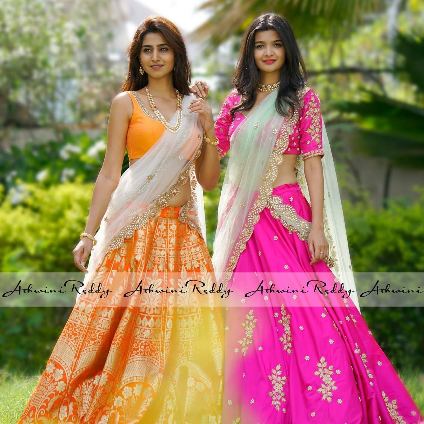 Beautiful orange and pink color lehengas with designer blouses from Ashwini Reddy.