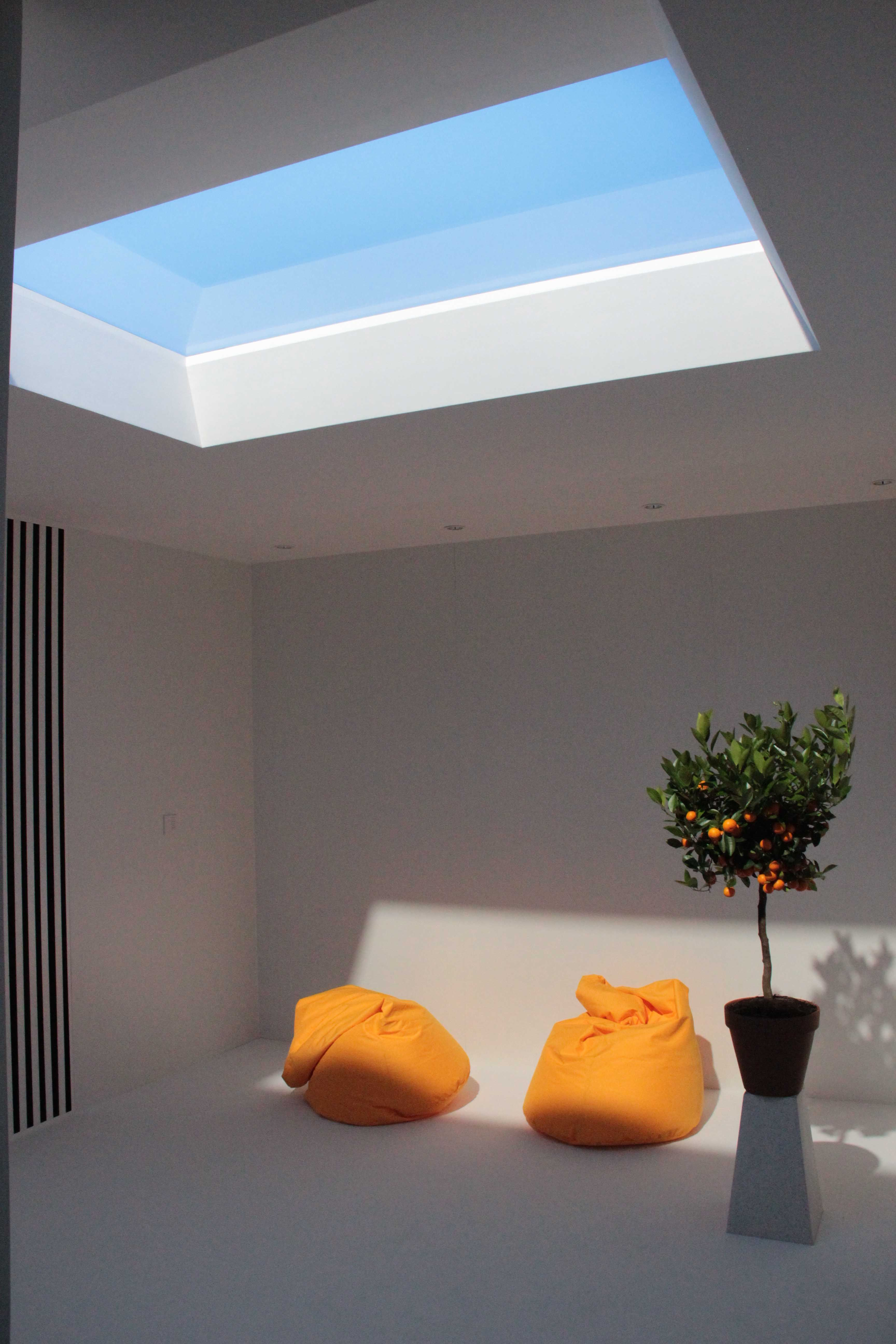 A Great Solution For Windowless Spaces The Coelux Artificial Skylights Reproduce Sunlight And The Sky Experien Skylight Residential Design Artificial Sunlight