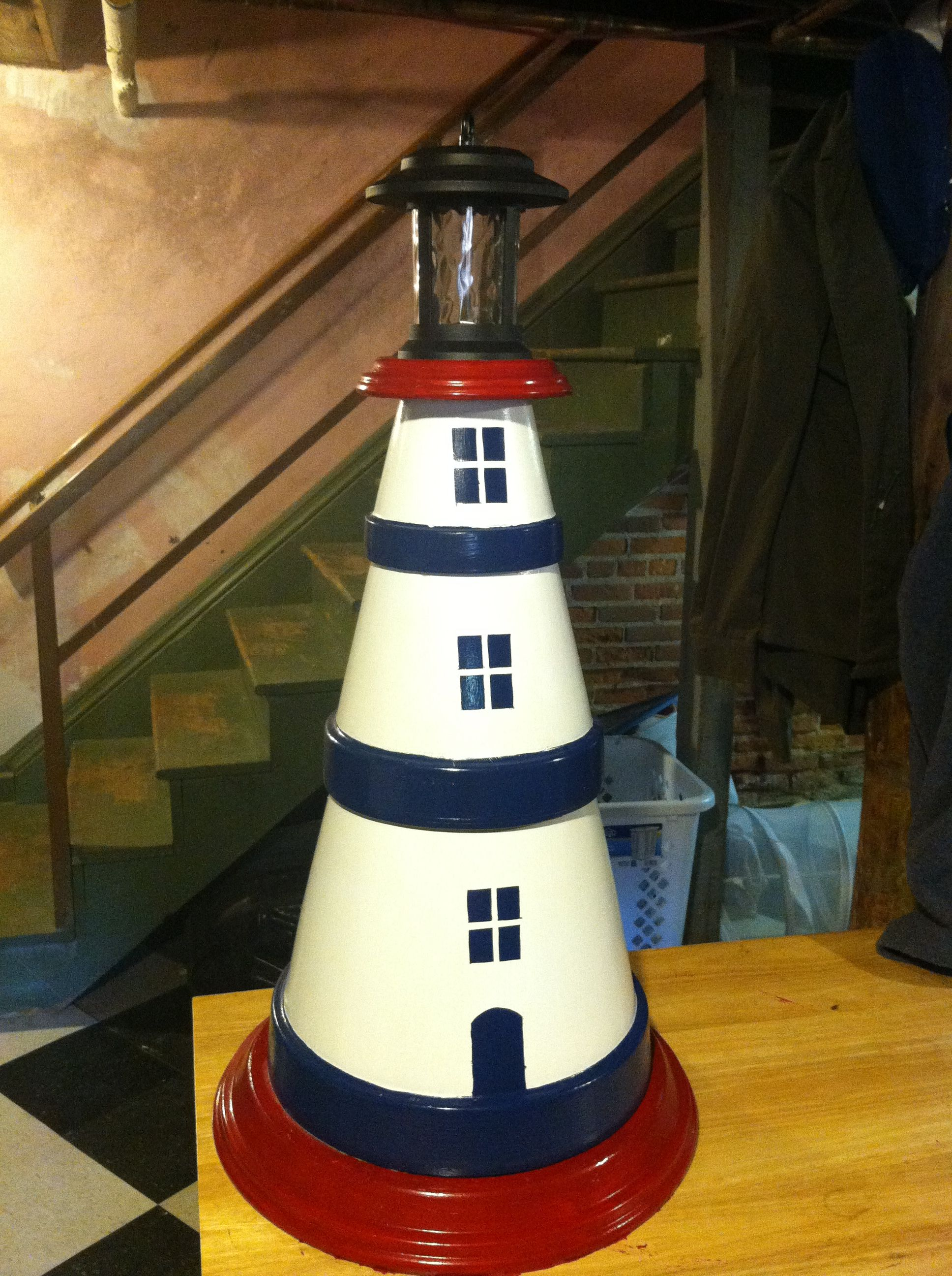 DIY terra cotta pot lighthouse I made this using 3 terracotta pots