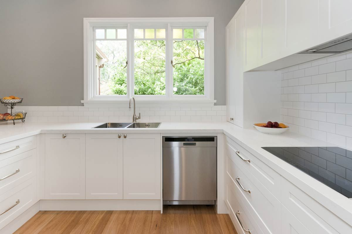 Premier Kitchens Simplistic All White Premier Kitchen Featuring Smartstone S Amara This Soft Small Kitchen Renovations White Kitchen Bench Kitchen Benches