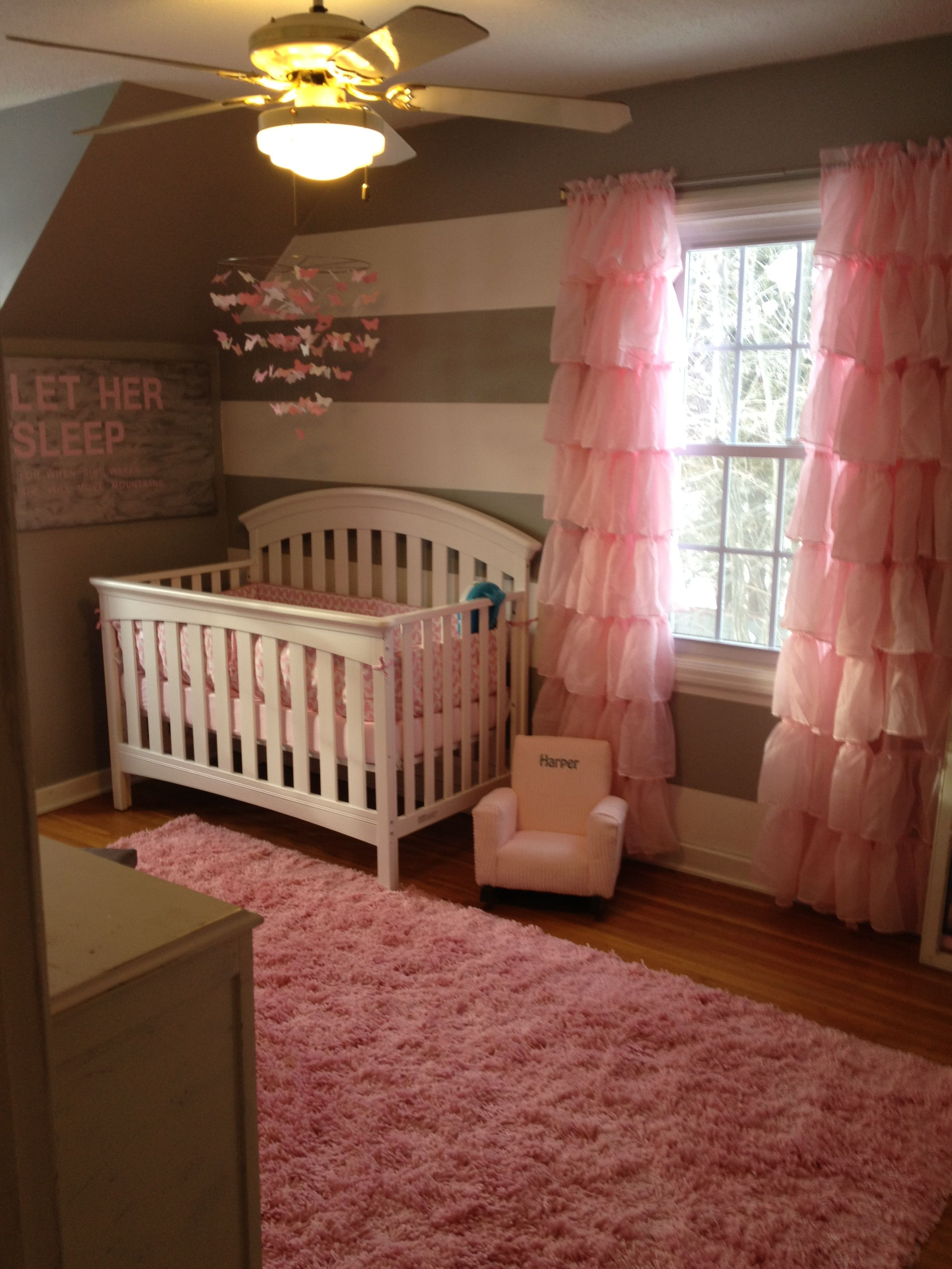 Pink, white and gray nursery gray walls... white furniture