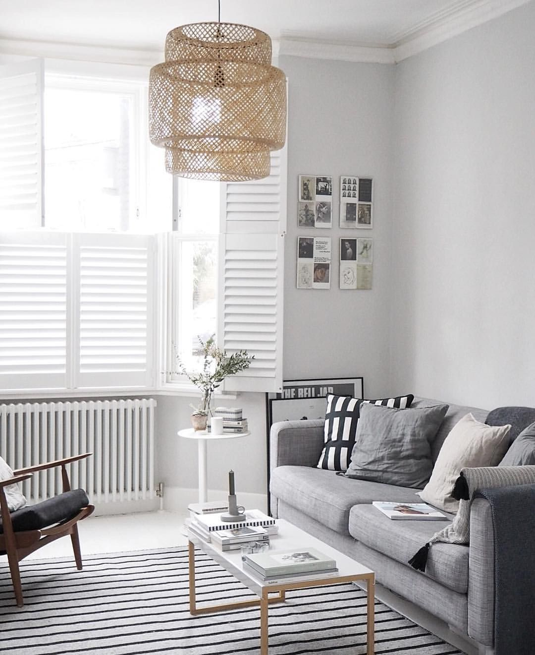 lovely light airy living room with soft grey tones and an