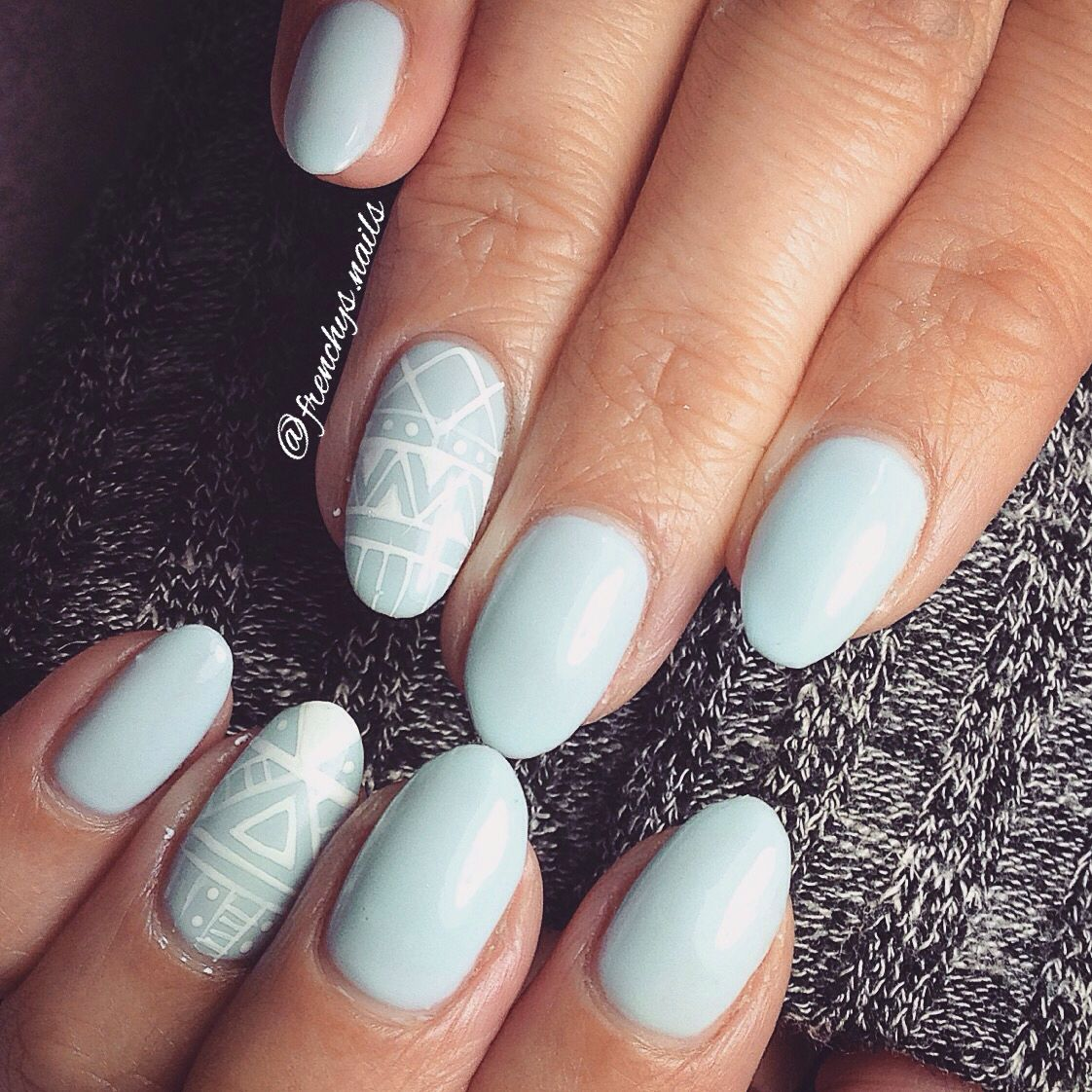 Pastel baby blue nails with tribal design