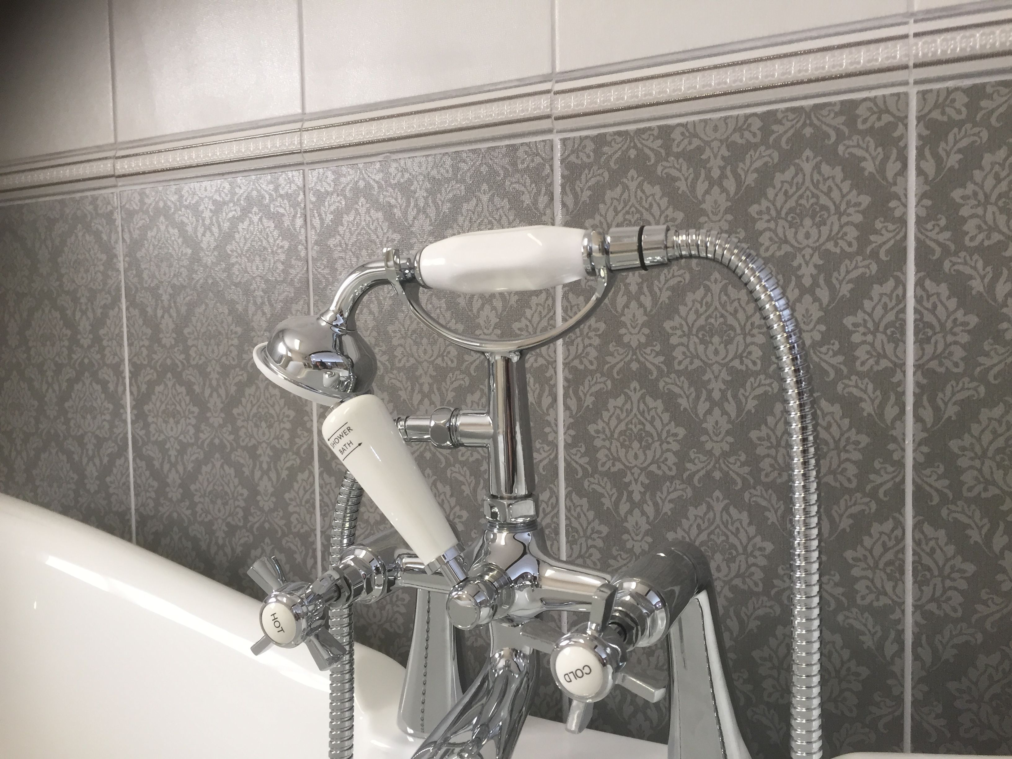 This wallpaper look feature tile compliments the antique telephone ...