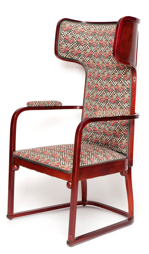 JOSEF HOFFMAN Wingback chair, c. 1903, manufactured by Jacob & Josef Kohn, Vienna, model NR. 667. Beech, bent wood, moulded plywood, red-brown stained, new upholstery in the style of Wiener Werkstätte. H. 125 cm; 63 x 55 cm.  |  SOLD $4,230 Germany 2011