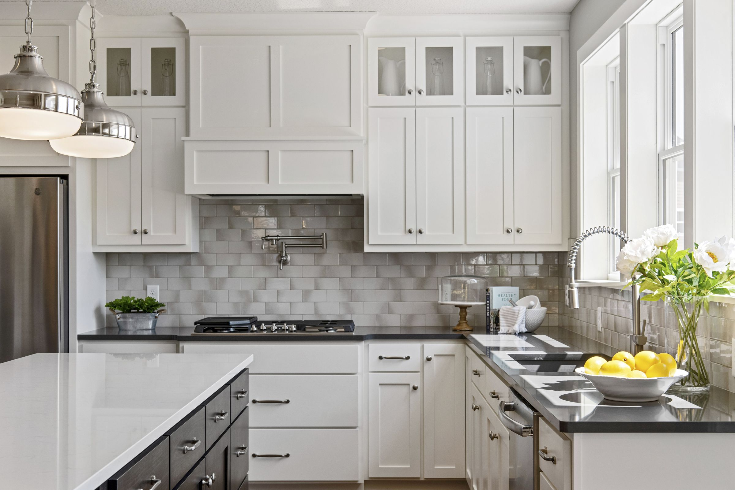 Chef's dream kitchen with large windows above under mount ...