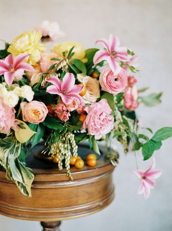 YES to all the colours in this bouquet! Sweet Floral Centerpiece in Bright Pink and Yellow | Rebecca Hollis Photography | http://heyweddinglady.com/get-published-wedding-blog/