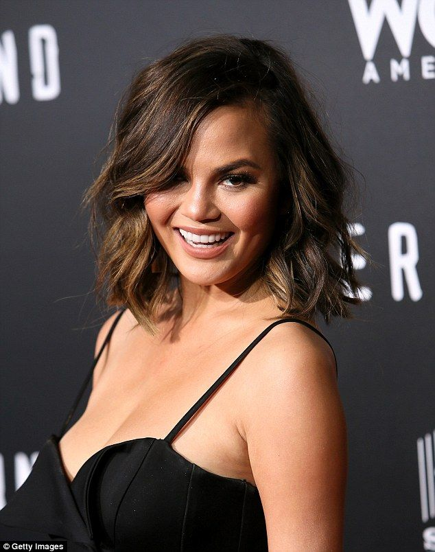 Chrissy Teigen Is A Vision In Black Pantsuit At Premiere Chrissy Teigen Hair Short Hair Styles For Round Faces Short Hair Styles