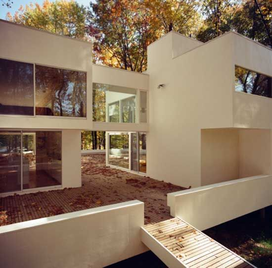 Exterior View Of A Home With White Faceade And Large Windows. Modern House  DesignModern ...