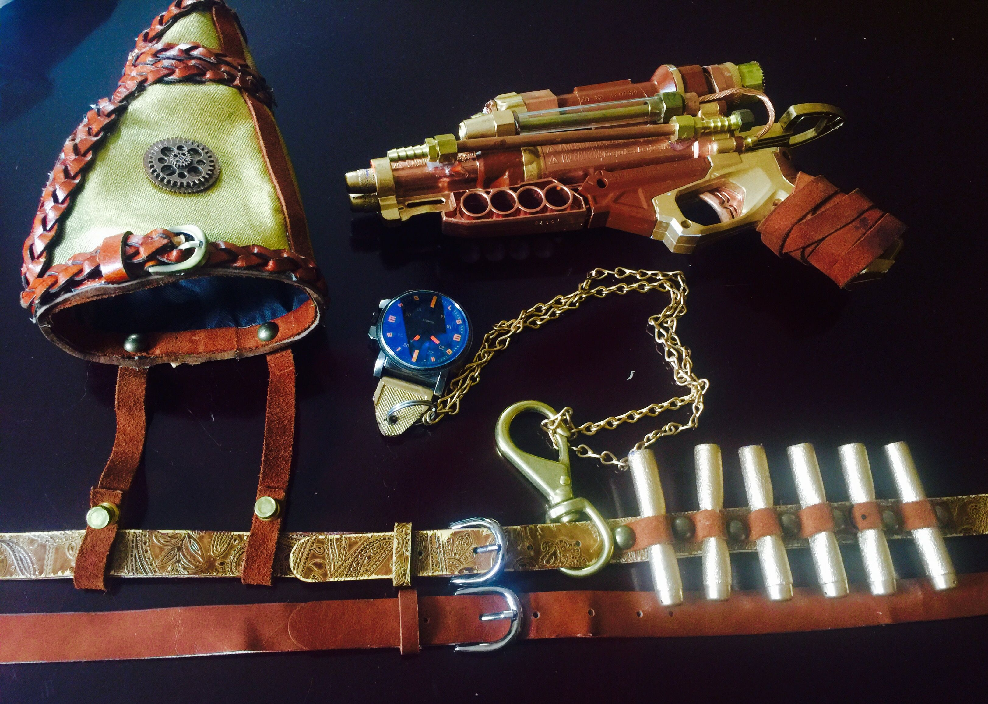 Steampunk gun and holster, ammo belt, time peace.