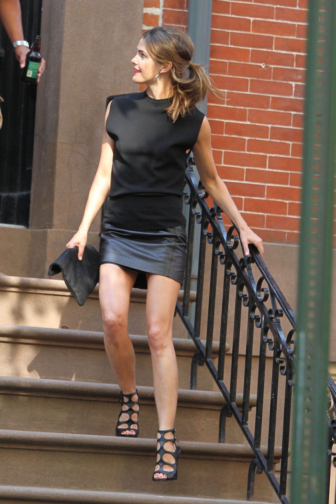 Black muscle tank, black leather mini skirt, black statement heels ...